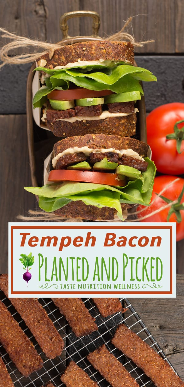 tempeh bacon sandwich next to tomatoes
