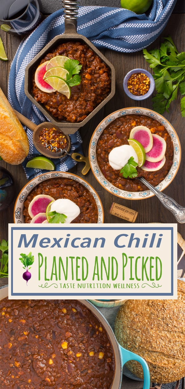 mexican chili in bowls and pan next to wine and bread