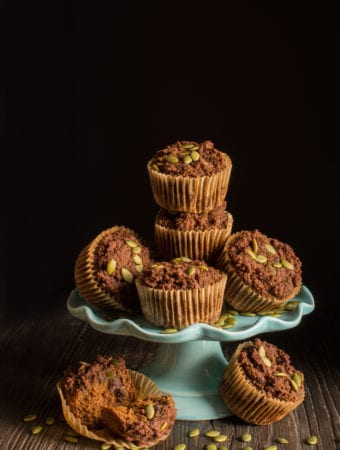pumpkin spice muffins on turquoise cake stand