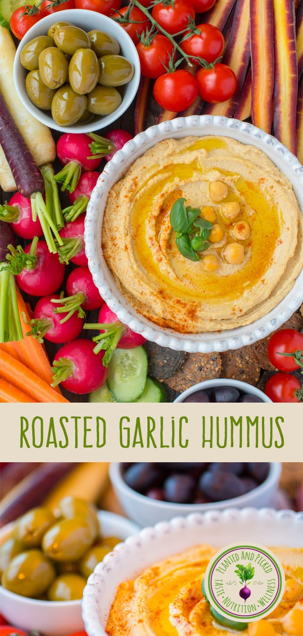 roasted garlic hummus surrounded by fresh vegetables
