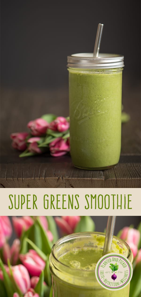 super greens smoothie in glass jar next to flowers
