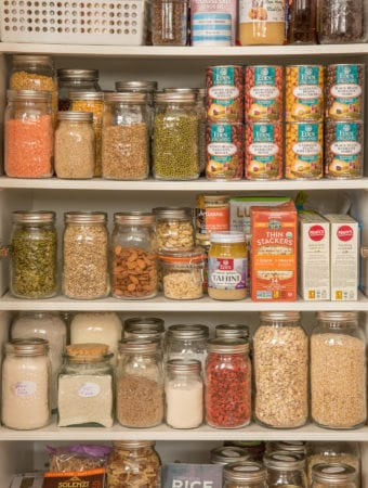 pantry stocked with plant-based items in jars boxes and cans