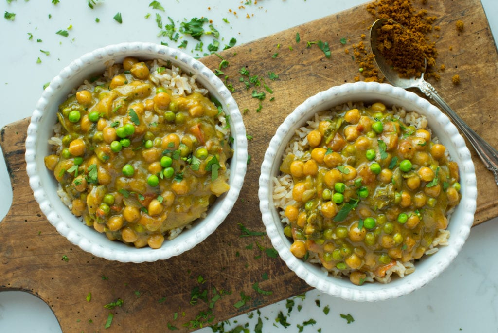 coconut chickpea curry masala in two bowls on rice