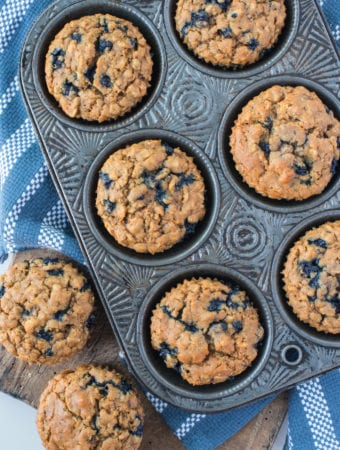 blueberry oatmeal muffins in muffin tin