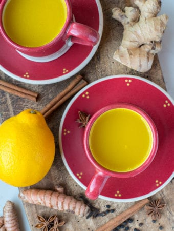 detoxification tea in mugs on cutting board