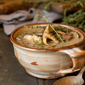 homemade mushroom soup in pottery cup