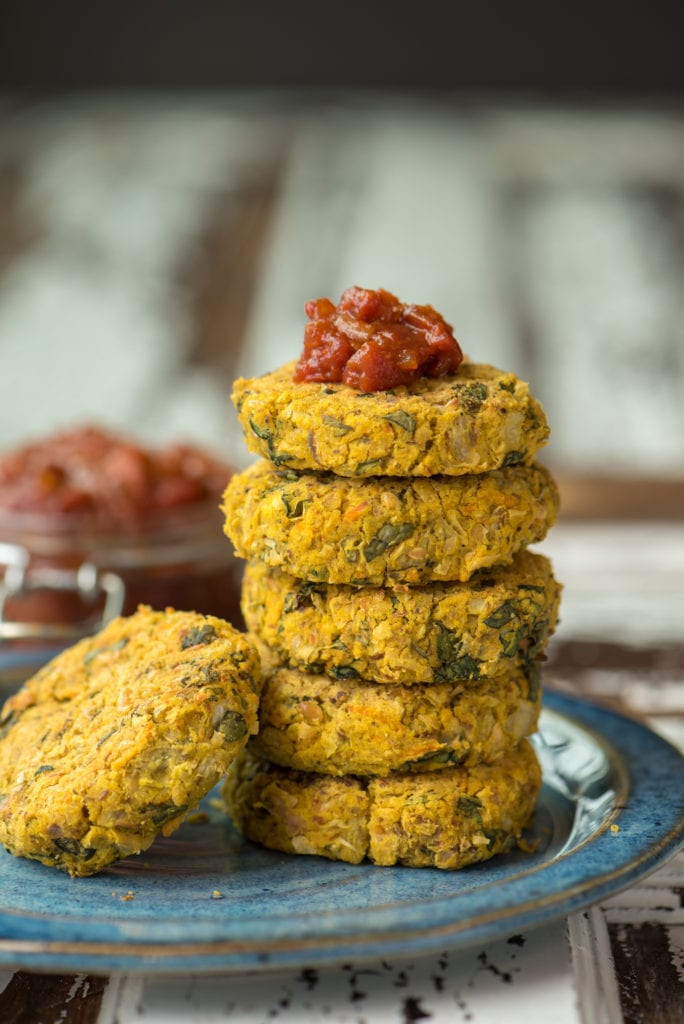 stack of white bean and artichoke patties on plate