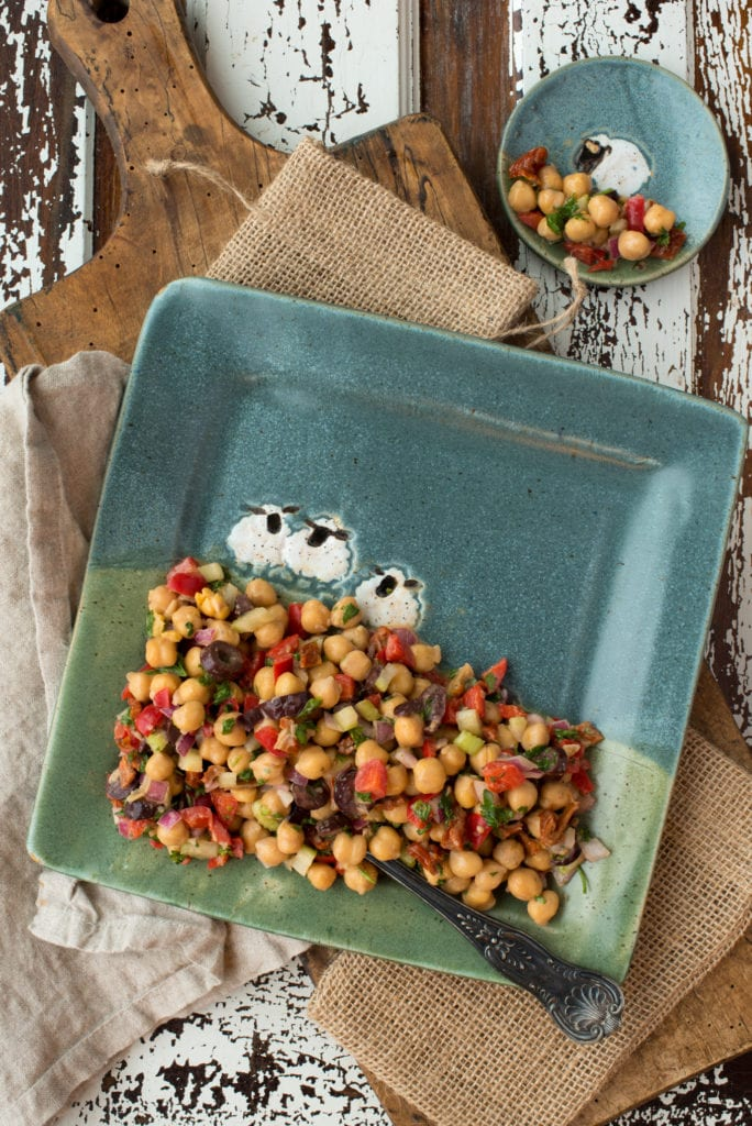 greek chickpea salad on plates