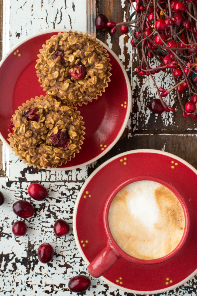 oatmeal cranberry muffins on plate next to latte