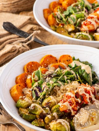 basic buddha bowl with vegetables and quinoa in two bowls