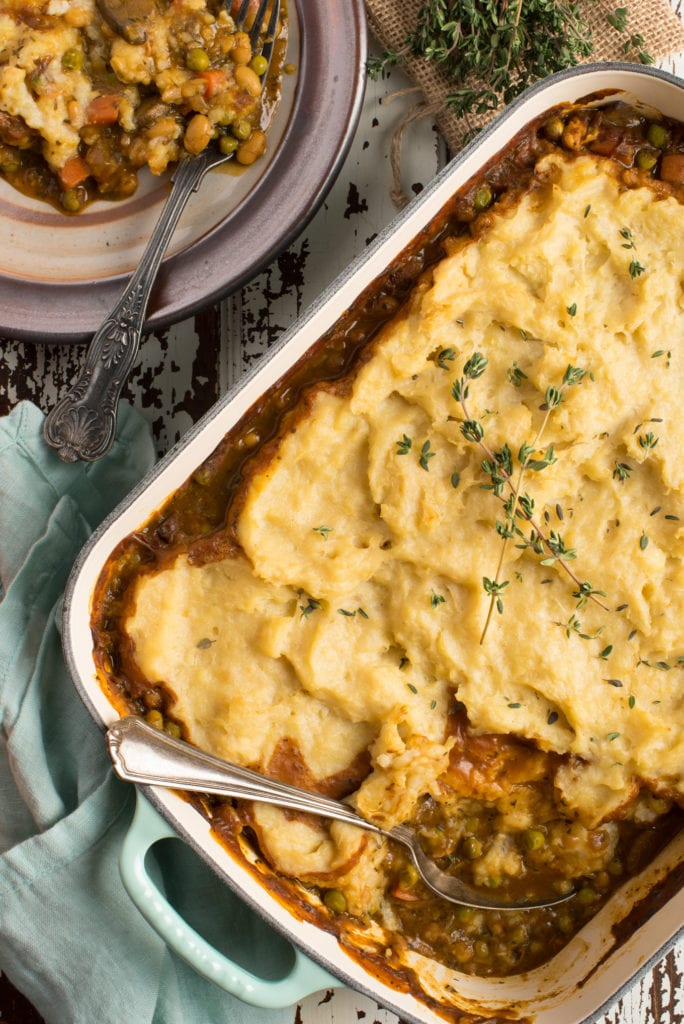 hearty vegetable shepherd's pie in pan and on plate