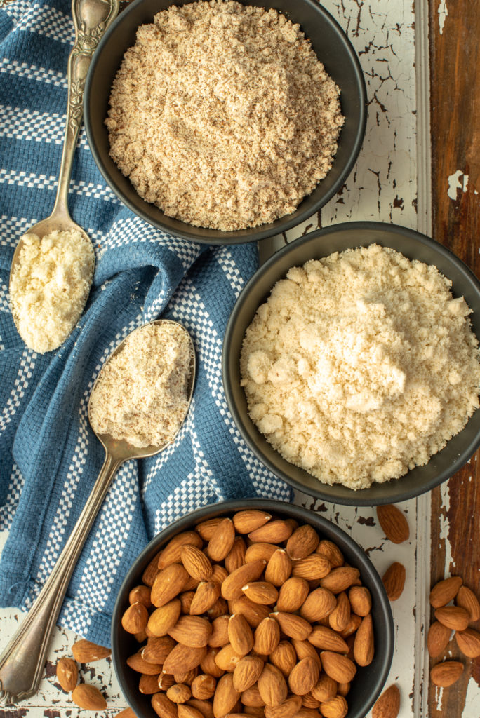almonds, almond meal and almond flour in bowls