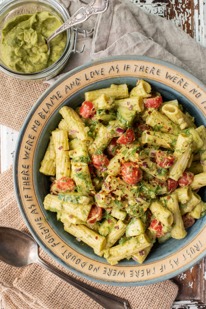 avocado dill pasta salad in serving bowl