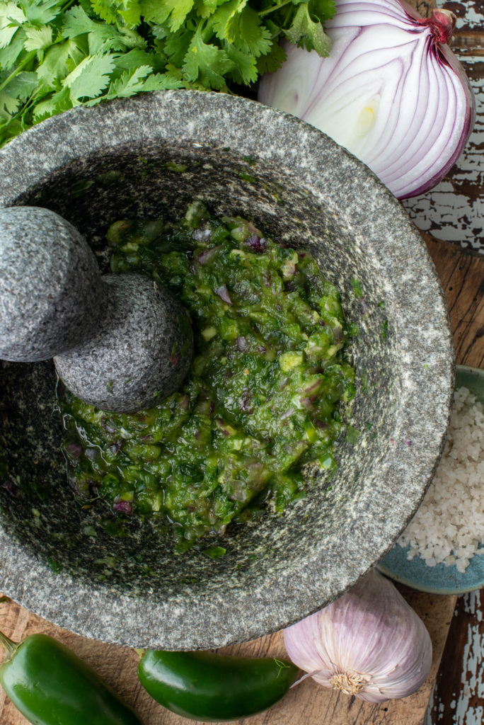 jalapeno peppers, onion and cilantro in molcajete