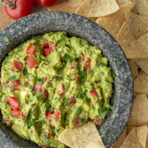 homemade guacamole in molcajete with tortilla chips