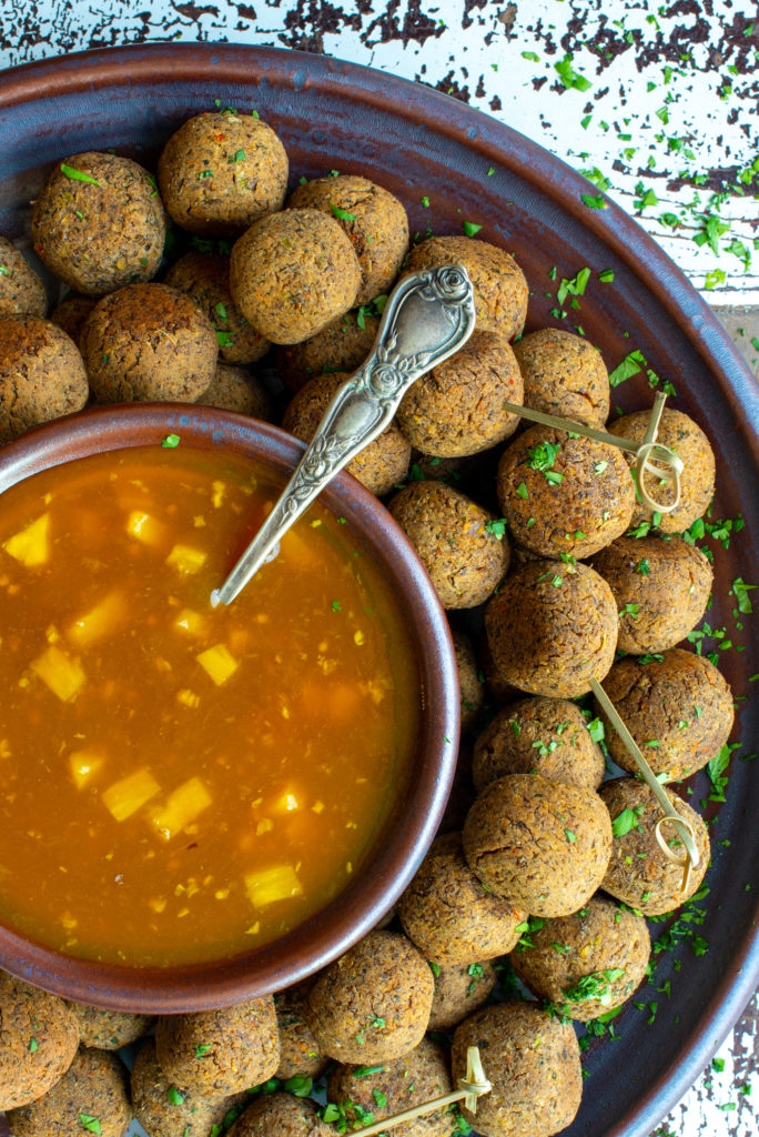 pineapple sweet and sour sauce with lentil balls on platter