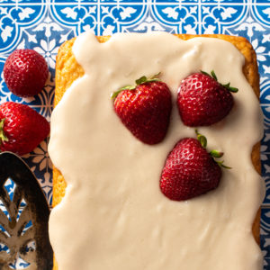 lemon strawberry loaf garnished with strawberries