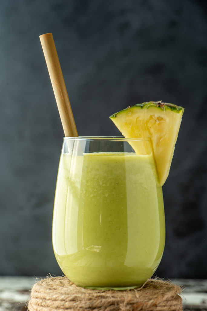 refreshing pineapple salsa smoothie in glass on roll of twine