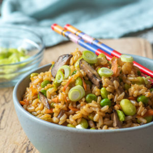 fried rice in bowl on cutting board