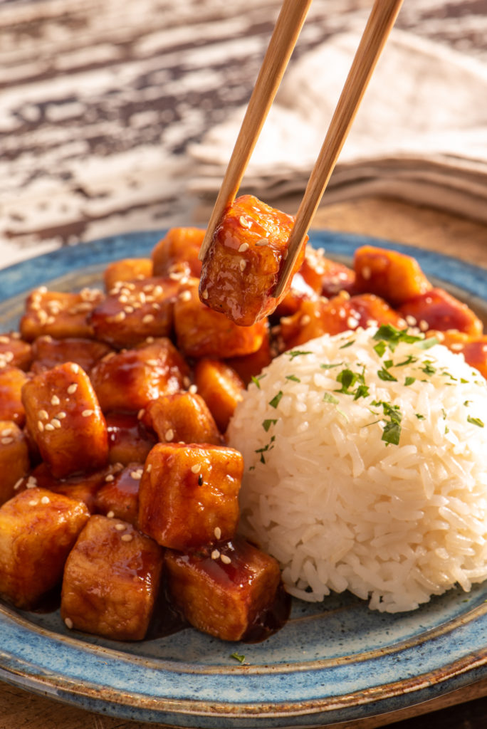 tofu on plate with chop sticks