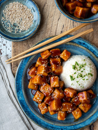 spicy sticky tofu with rice on plate