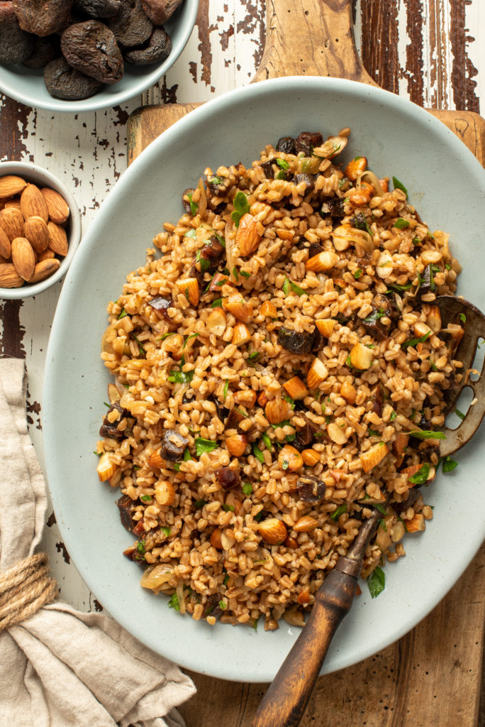 wholesome and healthy farro salad on platter sitting on cutting board