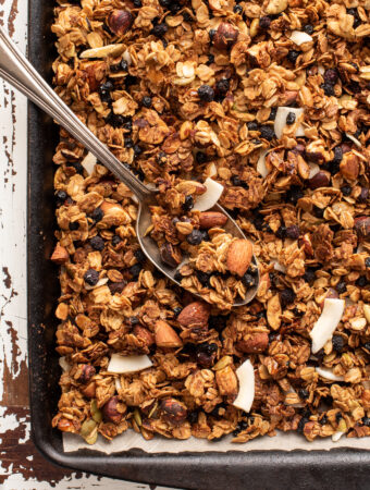 coconut blueberry granola on baking sheet