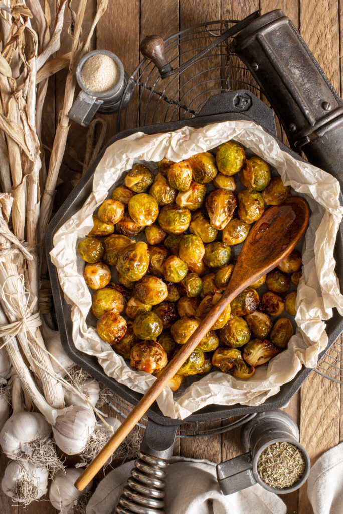 garlicky maple brussels sprouts in frying pan