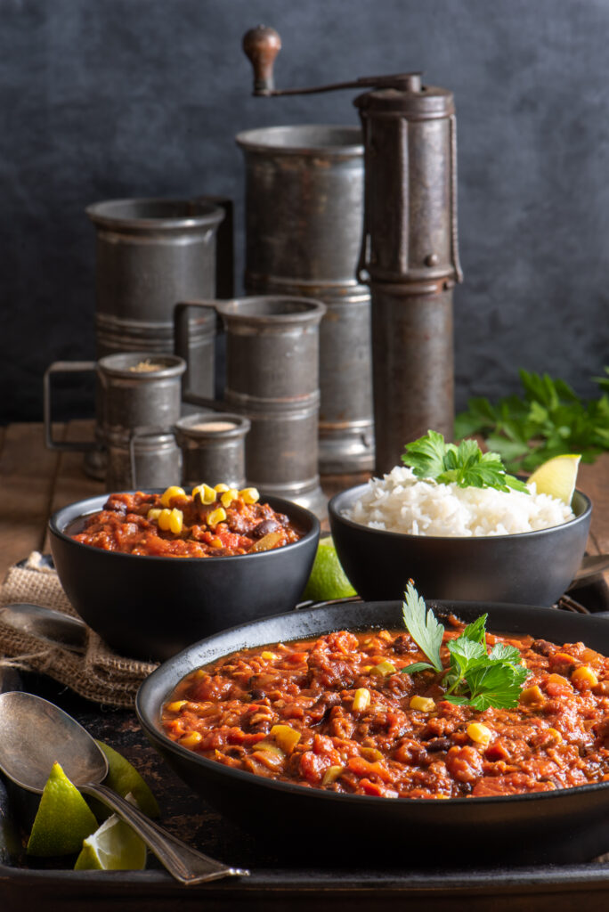 chili and rice in bowls