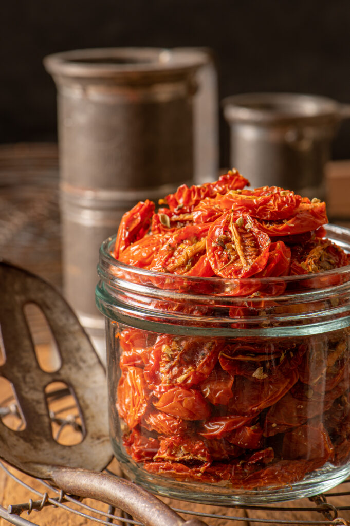 slow roasted cherry tomatoes in preserving jar