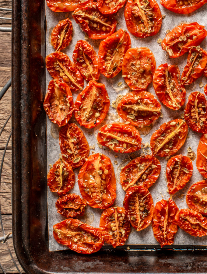 slow roasted cherry tomatoes on baking sheet