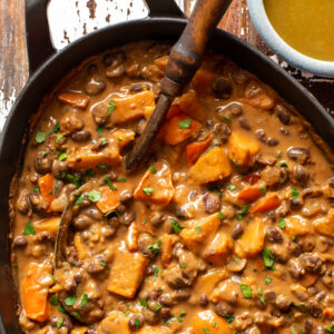 black bean and sweet potato stew in iron skillet - food gawker image