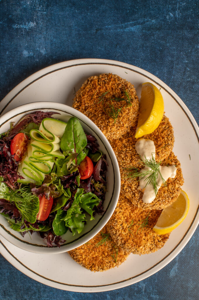 vegan crabless cakes with green salad on plate