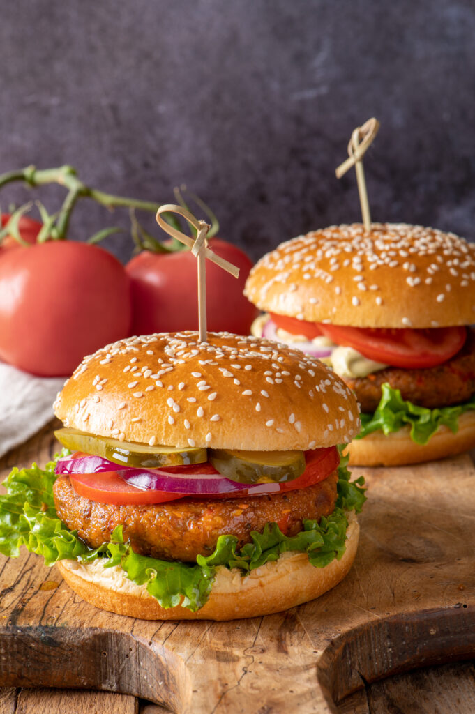 two chickpea veggie burgers on cutting board