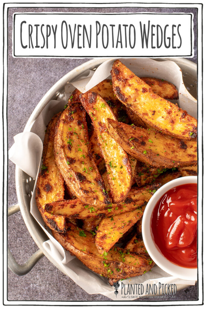 crispy oven potato wedges in colander with small dish of ketchup - pinterest image