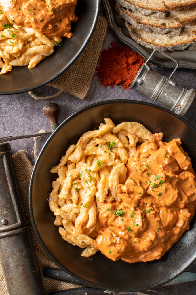 vegan hungarian tofu paprikash in two black bowls