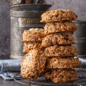 nut butter breakfast cookies stacked on cooling rack - recipe image