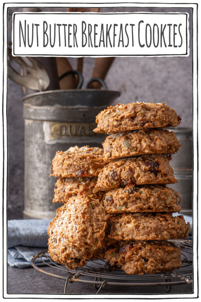 nut butter breakfast cookies stacked on cooling rack - pinterest image