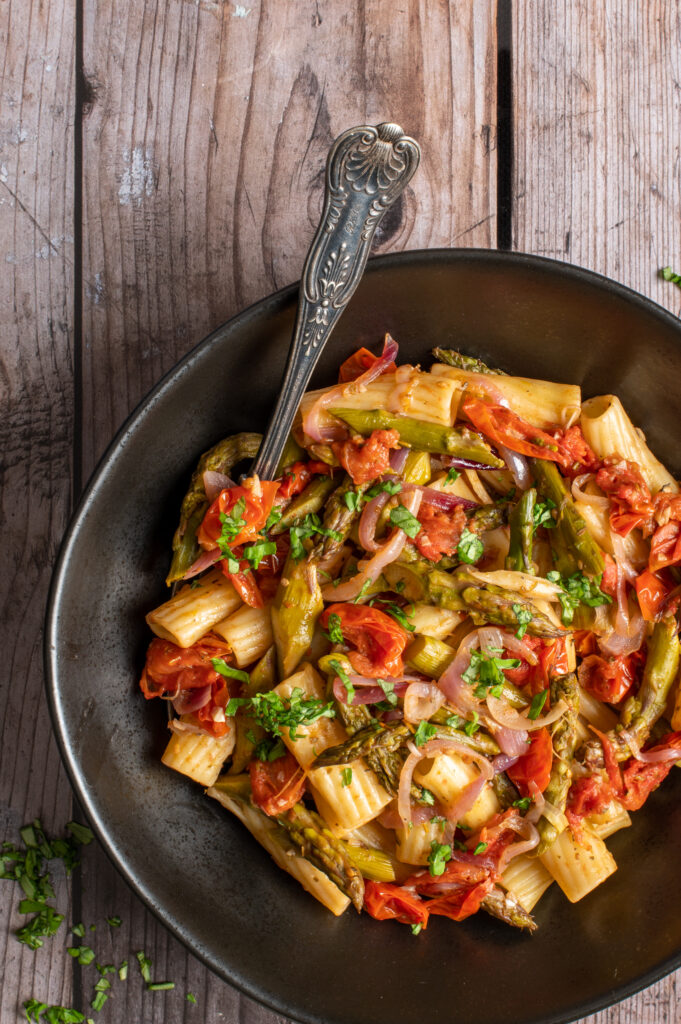 simple asparagus rigatoni in black bowl
