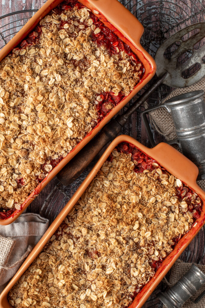 strawberry coconut crumble in two baking dishes
