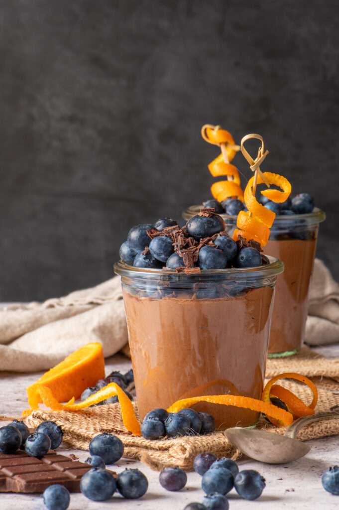 creamy chocolate coconut pudding in jars