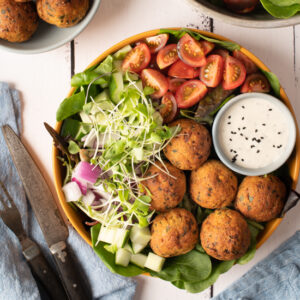 falafel plate with tomatoes, cucumber and greens