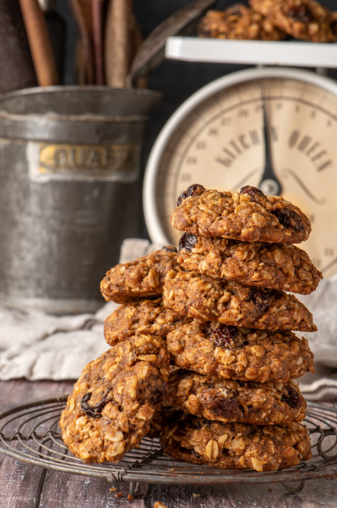 vegan oatmeal raisin cookies on cooling rack with kitchen scale in background